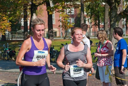 Two runners in the last kilometer during the yearly Canal Run 2011, Breda, Netherlands, October 2, 2011 Stock Photo - 10753095