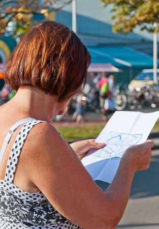 breda: A visitor studies the route during the yearly Canal Run 2011, Breda, Netherlands, October 2, 2011