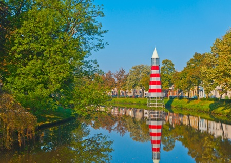 City view of the Academiesingel (Academy Canal) in Breda, a city in the Netherlands. The lighttower in the background is a colorful construction of the Italian architect and designer Aldo Rossi (1931 - 1997). Stock Photo - 10825568