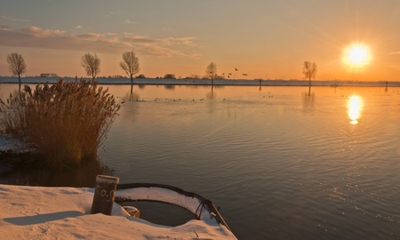 maas: Golden sunset above the river Bergse Maas in the Netherlands Stock Photo