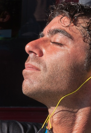 Dutch man basks in the sunlight at a terrace during the yearly Canal Run 2011, Breda, Netherlands, October 2, 2011