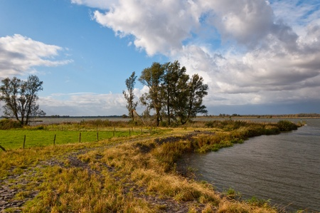 The Dutch river Amer in the province of North Brabant when the autumn storm comes. Across the river is the National Park De Biesbosch Stock Photo - 10977530
