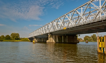 maas: Old truss bridge over the river Bergse Maas in the Netherlands Stock Photo