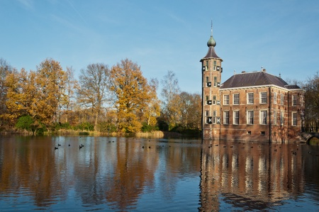 An ancient Dutch castle in the autumn sun on the outskirts of the city of Breda. The castle dates from the 15th century. photo