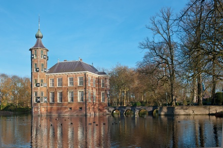 An ancient Dutch castle with a moat on the outskirts of the city of Breda. The castle dates from the 15th century. photo