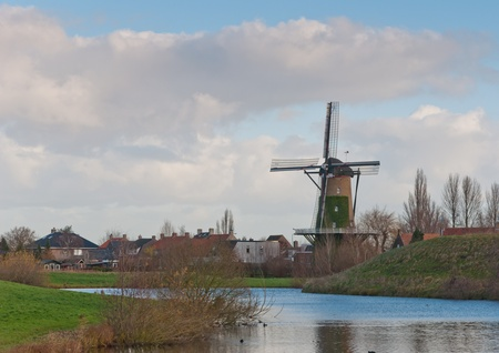 Windmill De Arend (lit.: The Eagle) in the Dutch village of Terheijden dates from the year 1742. The mill was burned in 1756 and immediately rebuilt. The mill is still in use as a corn mill. Stock Photo - 11555401