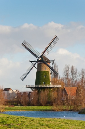 Windmill De Arend (lit.: The Eagle) in the Dutch village of Terheijden dates from the year 1742. The mill was burned in 1756 and immediately rebuilt. The mill is still in use as a corn mill. Stock Photo - 11555402