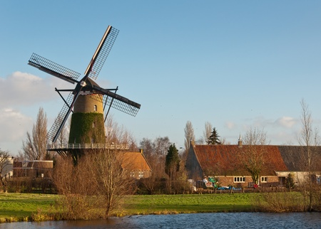 Windmill De Arend (lit.: The Eagle) in the Dutch village of Terheijden dates from the year 1742. The mill was burned in 1756 and immediately rebuilt. The mill is still in use as a corn mill photo