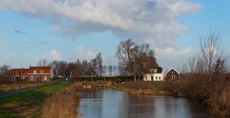 A picturesque autumnal view of a few colorful houses in the Dutch village Terheijden (North Brabant). Stock Photo - 11555405