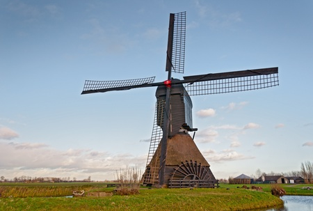 This windmill called Noordeveldse molen in the Dutch vilage of Dussen is a polder mill from 1795 photo