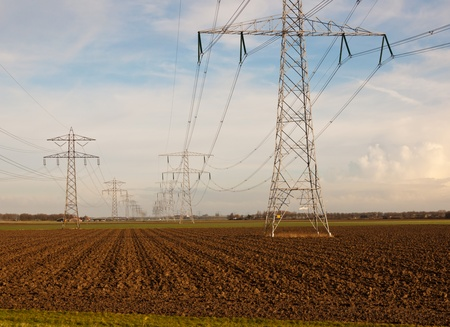 Power pylons in a rural countryside in the Netherlands. It is winter. photo