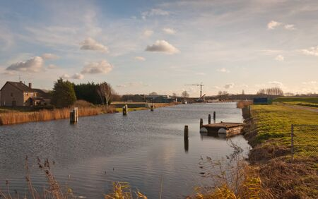A glance over the Roode Vaart canal from the Roodevaart hamlet, a municipality of the Dutch city of Moerdijk. photo