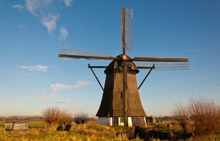 Windmill De Oude Doorn (Anno 1700) in the Dutch village of Almkerk, municipality of Woudrichem , province of North Brabant. The mill, until 1965 in use as a polder mill, is in restoration since 2011. photo