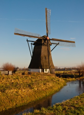 Windmill 'De Oude Doorn' (Anno 1700) in the Dutch village of Almkerk, municipality of Woudrichem , province of North Brabant. The mill, until 1965 in use as a polder mill, is in restoration since 2011. photo