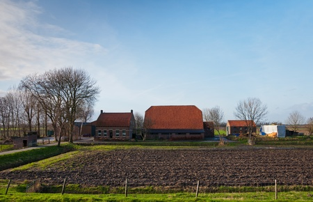 Traditional farmhouse with stable and barn near the small Dutch village of Blauwe Sluis.