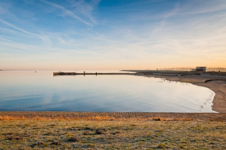 The lough of the  Oosterschelde (Zeeland, Netherlands) near Julianadorp and the dike from South Beveland to North Beveland. It is dawn and the sun is still low. photo