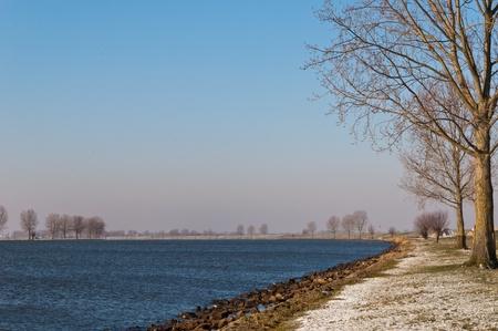 maas: The river Bergsche Maas in winter. The first snow has fallen.