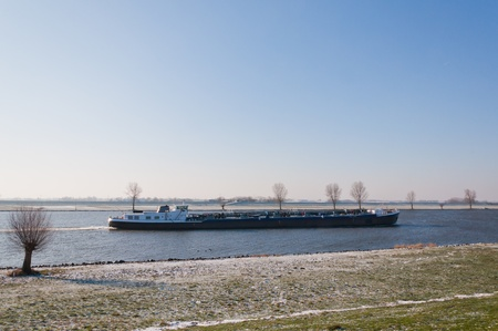 maas: Inland vessel on the Dutch river Bergsche Maas (North-Brabant). It is winter and the first snow has fallen.