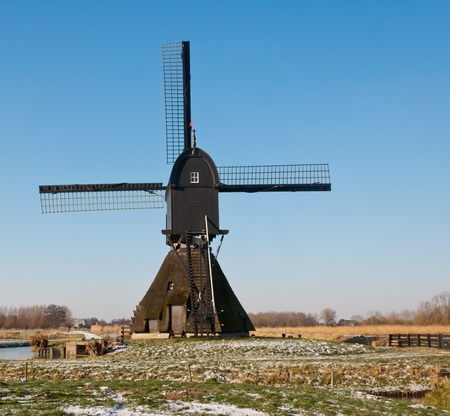 This windmill Noordeveldse molen in the Dutch village of Dussen is a polder mill from 1795. Until 1964 the mill has been used as a water pump for the low-lying polder. The mill was restored in 1969 and, after a fire in 1992, reestablished in 1997. Stock Photo - 12307359