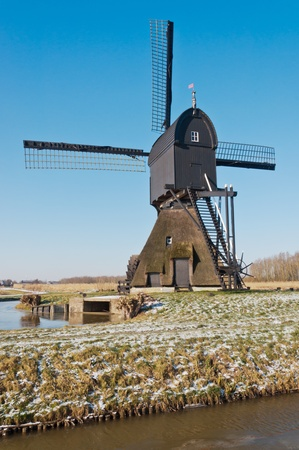 This windmill in the Dutch village of Dussen is a polder mill from 1795. Until 1964 the mill has been used as a water pump for the low-lying polder. The mill was restored in 1969 and, after a fire in 1992, reestablished in 1997. photo