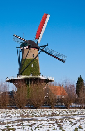 Windmill De Arend (lit.: The Eagle) in the Dutch village of Terheijden dates from the year 1742. The mill was burned in 1756 and immediately rebuilt. The mill is still in use as a corn mill. Stock Photo - 12295064