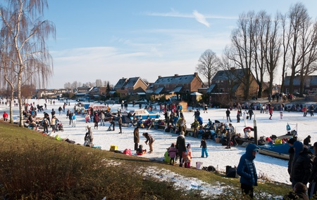 Ice fun in a Dutch village. A colorful and picturesque scene in Bruegelian style.