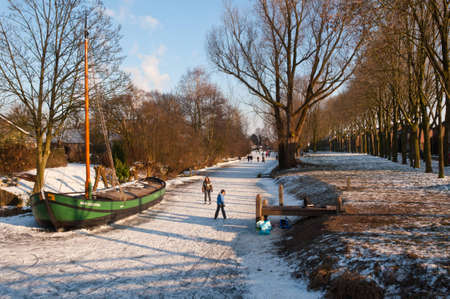 Drimmelen, North-Brabant, Netherlands, February 10, 2012,  On the ice of the frozen canal of the small Dutch village of Drimmelen Stock Photo - 12316249