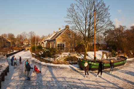 drimmelen: Drimmelen, North-Brabant, Netherlands, February 10, 2012,  On the ice of the frozen canal of the small Dutch village of Drimmelen