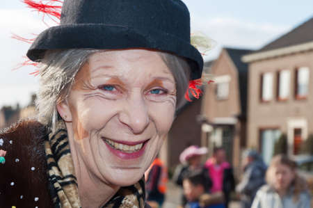 Made, North-Brabant, Netherlands – February 19, 2012 - Carnival Parade, impression of the people, smiling woman with her face painted as an old woman. Stock Photo - 12385685