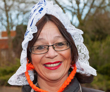 made in netherlands: Made, North-Brabant, Netherlands � February 19, 2012 - Carnival Parade, impression of the people, amused looking woman with glasses and a lace cap.