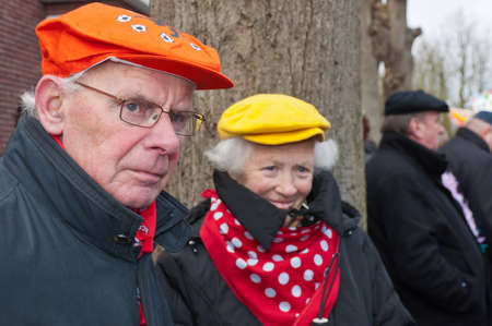 Made, North-Brabant, Netherlands - Carnival Parade, impression of the people, elderly man and his wife watch the parade.