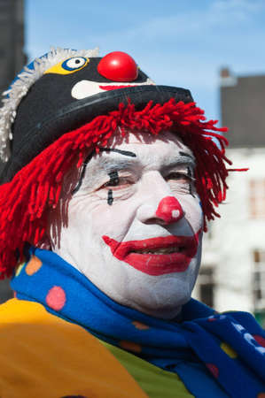 Breda, North-Brabant, Netherlands � February 20, 2012 � Carnival Parade, impression of the people, a colorful painted clown with a hat.