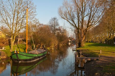 This is a  boat restored in 2011 as was used previously in National Park De Biesbosch  with the transport of reeds and osiers Stock Photo - 12978072