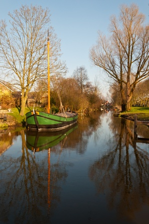 This is a  boat restored in 2011 as was used previously in National Park De Biesbosch  with the transport of reeds and osiers  Stock Photo - 12978083
