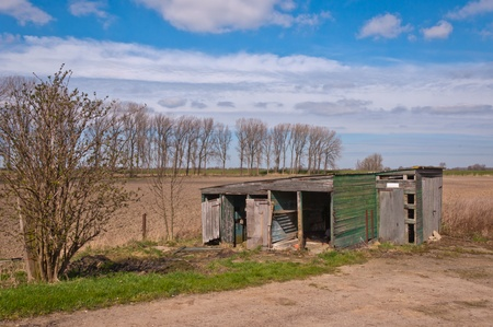 A small dilapidated wooden barn in the Netherlands. Stock Photo - 13076986