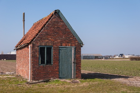 Dilapidated old barn in a Dutch landscape. Stock Photo - 13194526