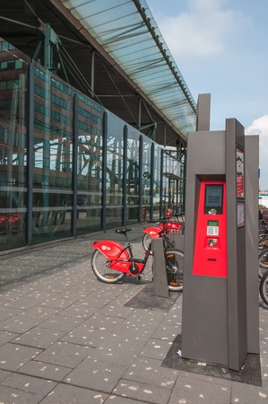 dropoff: Lille, Nord-Pas-de-Calais, France – April 14, 2011 – Bicycles of the VLille bike rental service available for on demand short-term hire, next to the Lille Europe Station. This is the credit card enabled bike station.