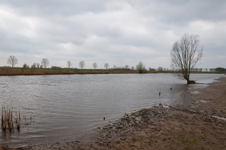 Inundated polder landscape in the Netherlands on a cloudy day. photo