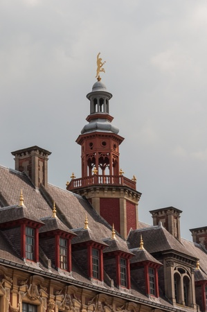 Closeup of the tower of La vieille bourse de Lille (lit.: The old stock exchange) in the center of Lille, Capital of Nord-Pas-de-Calais, France. Stock Photo - 13386336