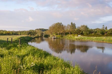 The small river Mark winds through the landscape near the Dutch village of Ulvenhout (North-Brabant). photo