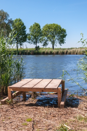 angling: Wooden angling plateau at a natural pond in the Netherlands  Stock Photo
