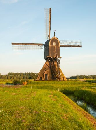 Backside of a Dutch windmill early in the morning  photo