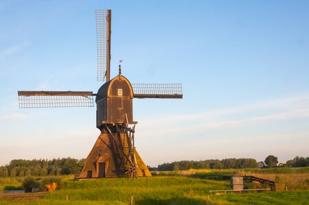 Rear of a Dutch windmill early in the morning  photo