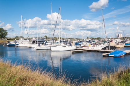 drimmelen: Overlooking a marina on a sunny day with a beautiful cloudy sky  Stock Photo