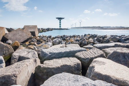 tonnes: Boulders and concrete block dam near Maasvlakte 2, the port of Rotterdams land reclamation project. The concrete cubes weigh over 40 tonnes a piece and measure 2.5 by 2.5 by 2.5 m.