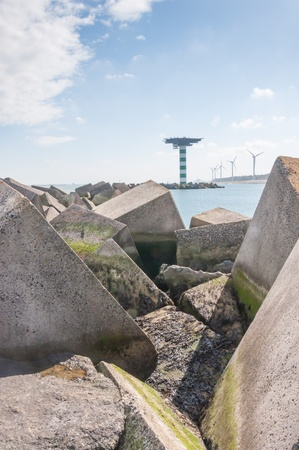 tonnes: Details of a concrete block dam near Maasvlakte 2, the port of Rotterdams land reclamation project. The concrete cubes weigh over 40 tonnes a piece and measure 2.5 by 2.5 by 2.5 m.