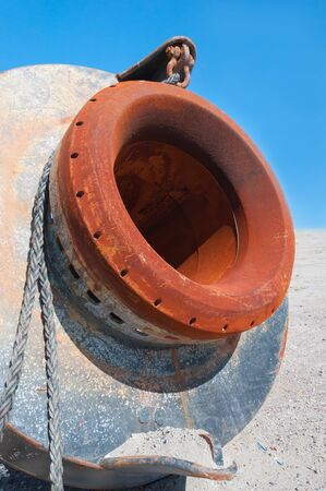 Closeup of a rusty and colorful mechanical object on the beach of the Maasvlakte in Europort, Netherlands. photo