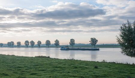 It is still early in the morning  Only one ship sails on the foggy river Stock Photo - 15758480