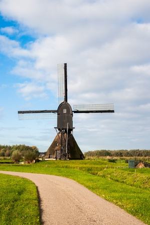 windmill Noordeveldse molen in the Dutch village of Dussen photo
