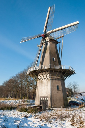 Historic windmill Nooit Gedagt (lit.: Never Thought) on the wall of the old Dutch fortress city Woudrichem was built around 1662 and is still in use as a corn mill. Stock Photo - 16743000